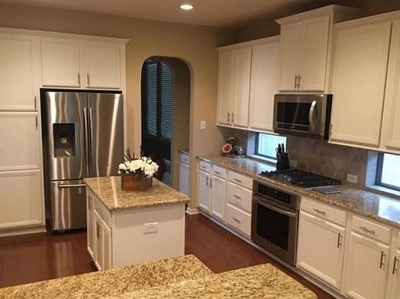 Just finished kitchen cabinets after spray painting by House painters vaughan