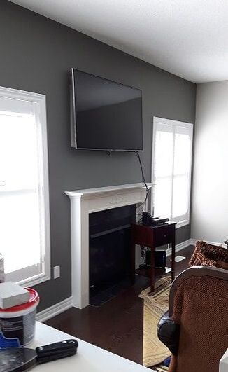Interior painting in living room around fireplace in Vaughan